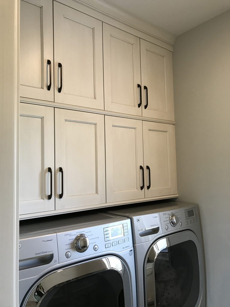 Above laundry cabinets