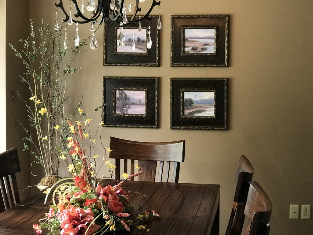 Dining room table with art wall