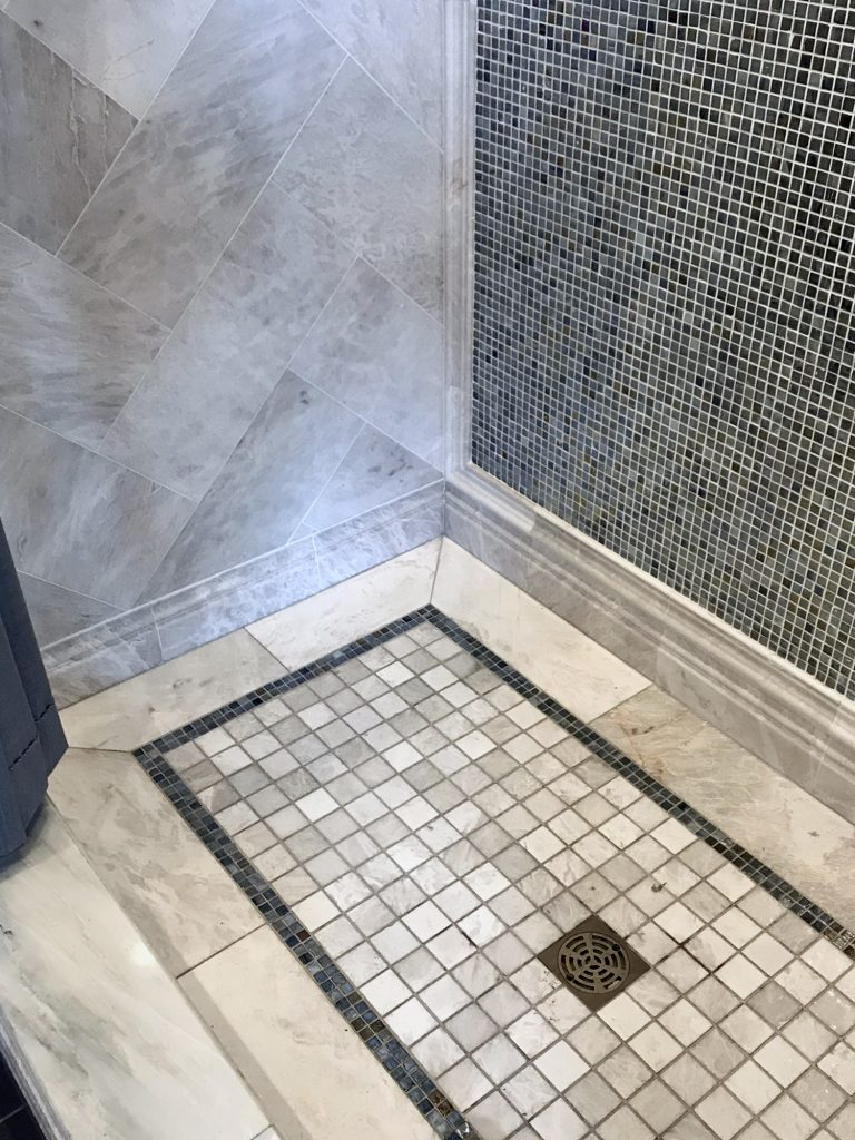 Glass mosaic tile shower floor