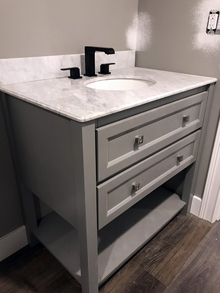 Gray double drawyer vanity, light marble countertop