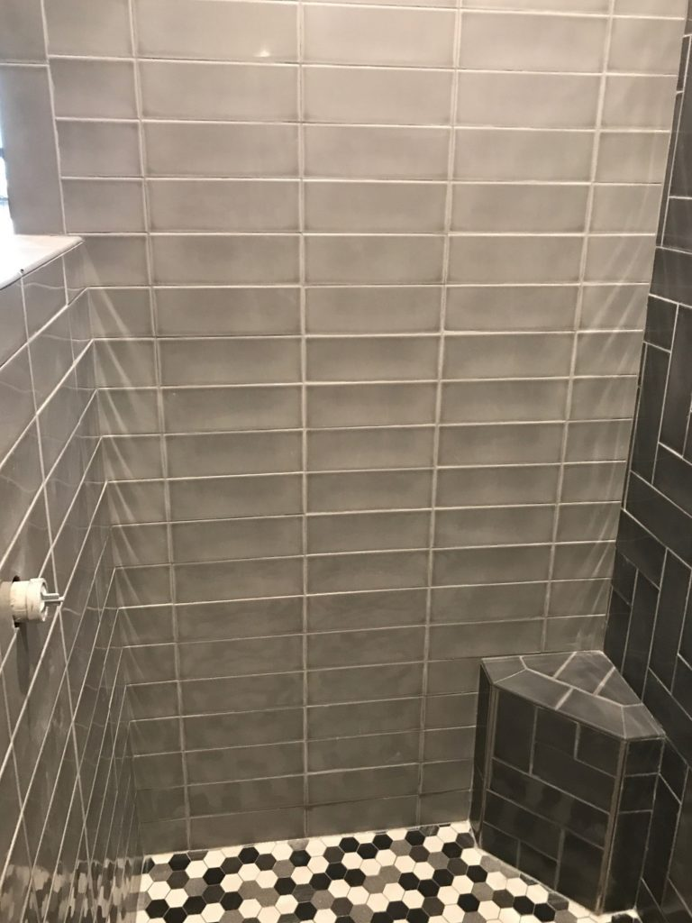 Gray glass stacked shower