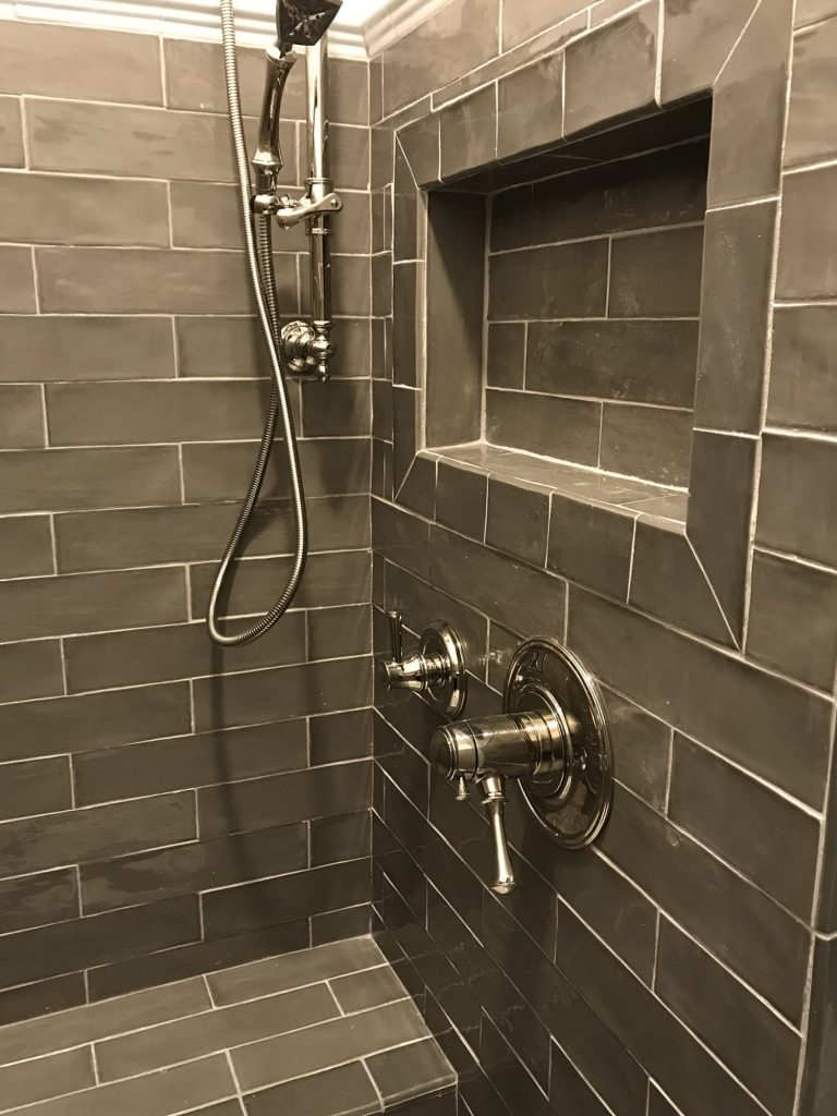 Gray glass shower, chrome fixtures
