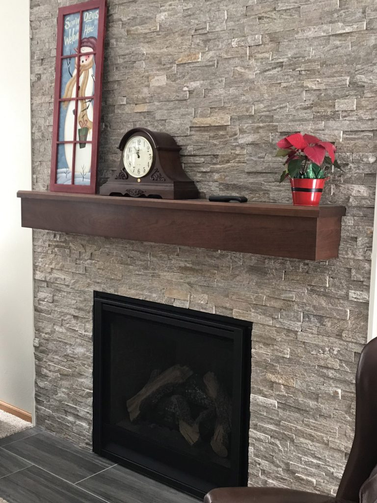 Stacked stone fireplace with Christmas decoration