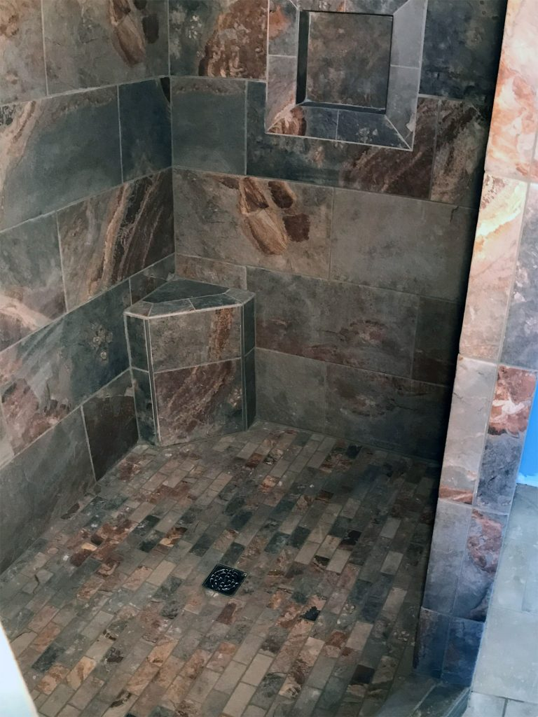 Dark stone tile shower surround