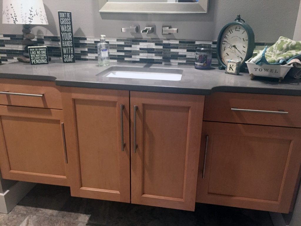 Gray counter vanity with bumpout