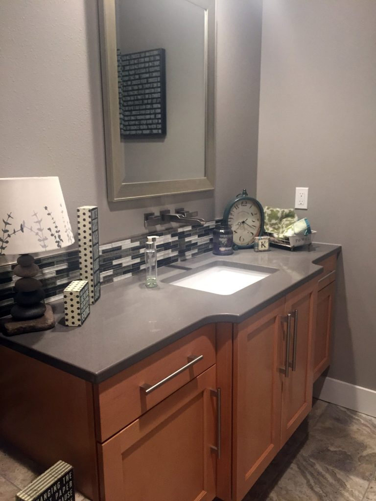 Gray counter midtone vanity with bumpout