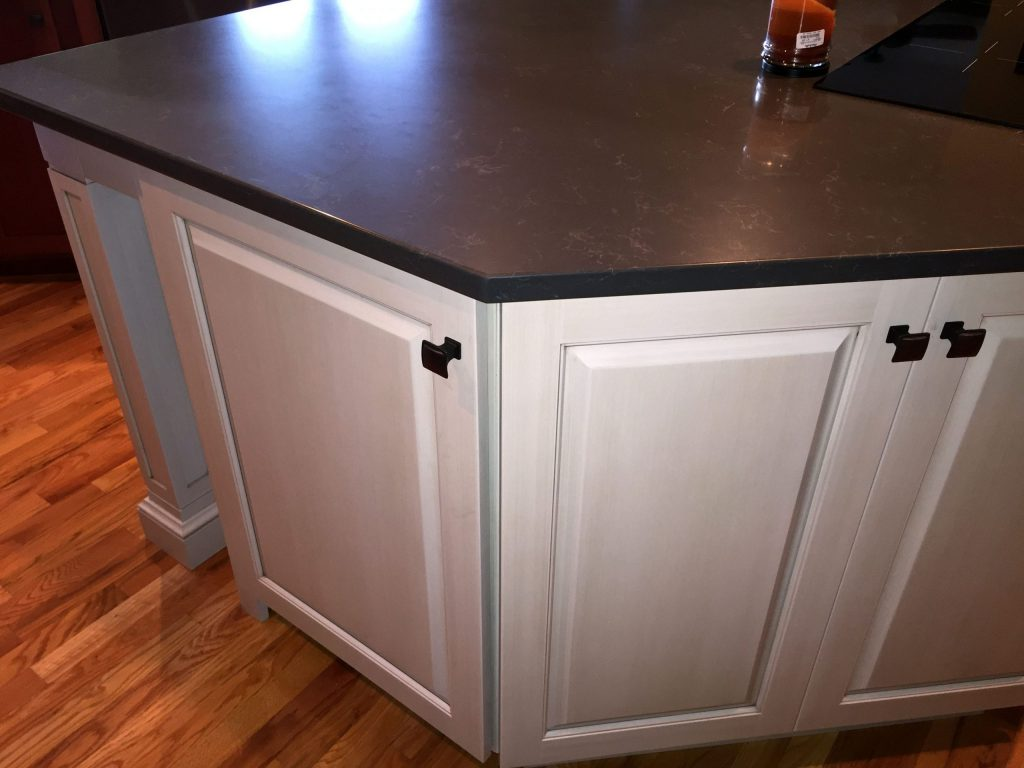 White kitchen island with dark countertop