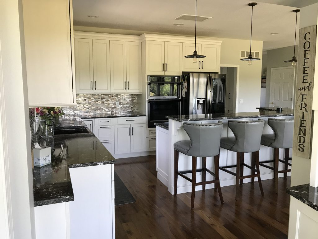 White kitchen with glass tiled backsplash