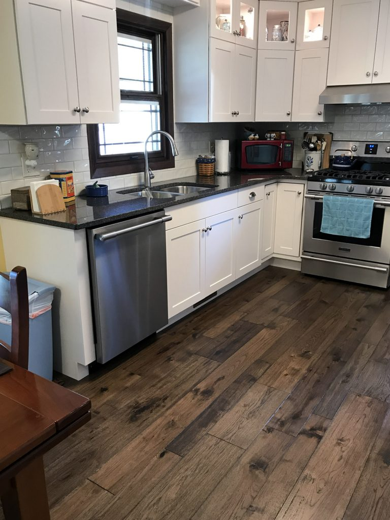 White Shaker cabinets, dark hardwood floors