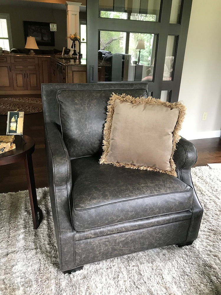 Distressed gray leather armchair