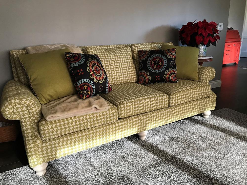 Herringbone couch, white leopard rug