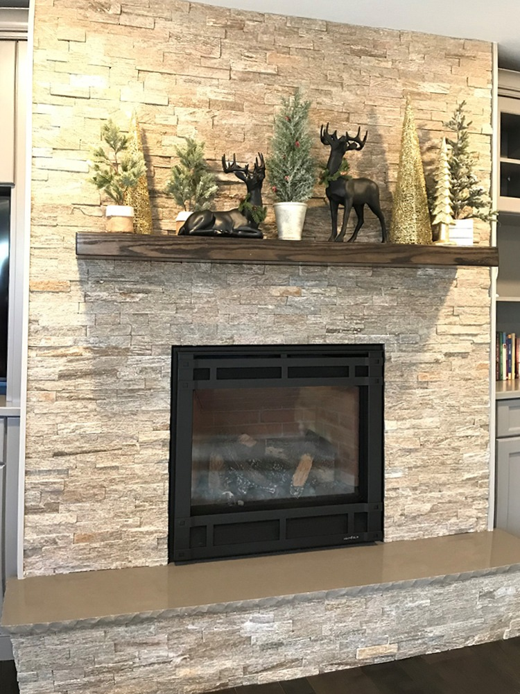 Stacked stone fireplace, decorated mantle