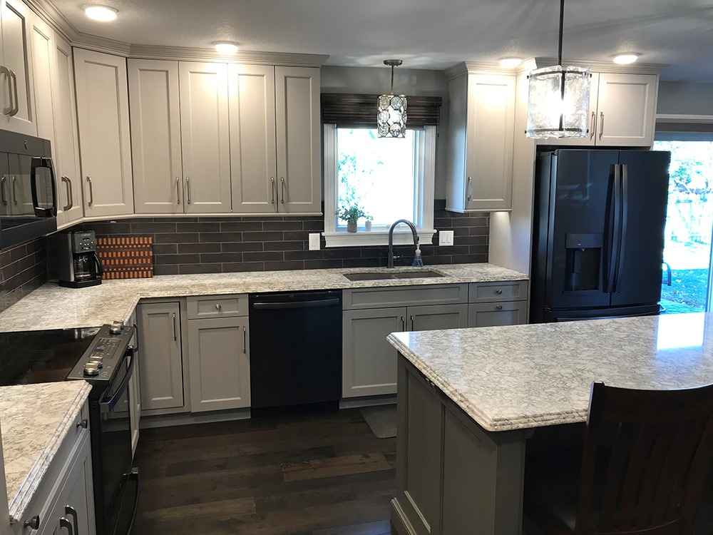 White kitchen cabinets, gray island