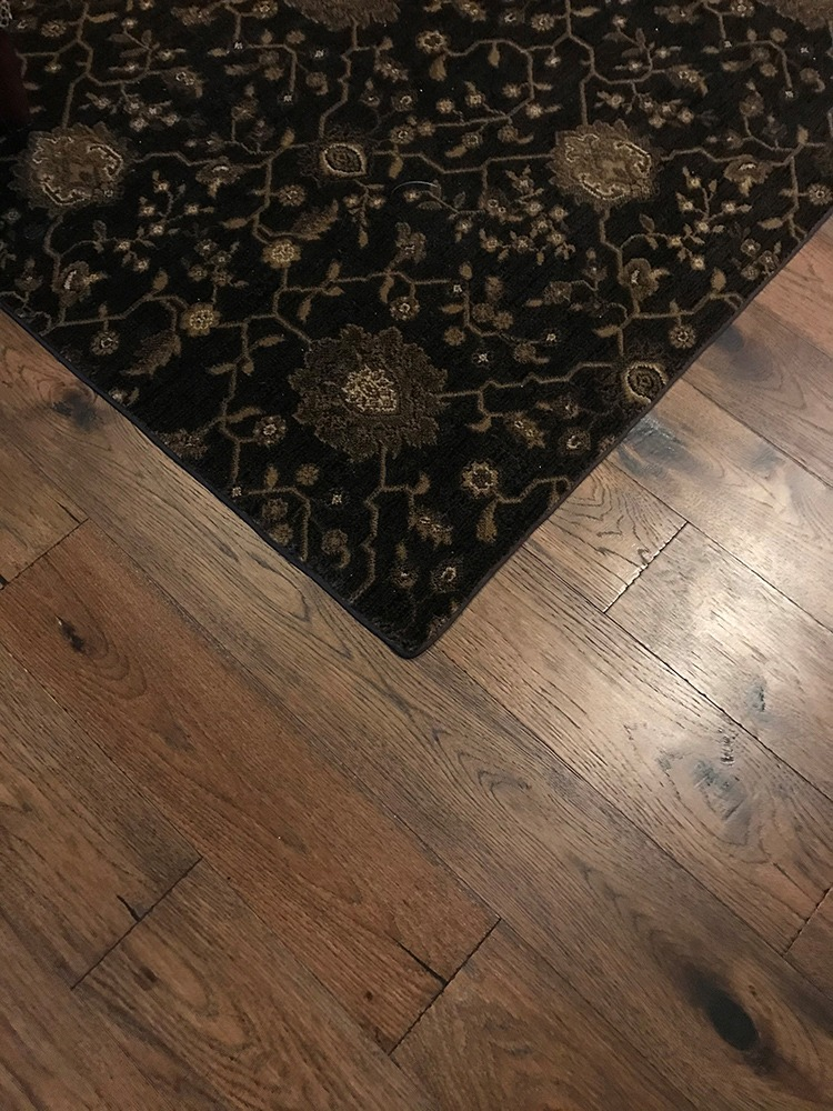 Floral rug on midtone wood