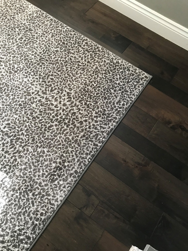 White leopard rug on dark hardwood