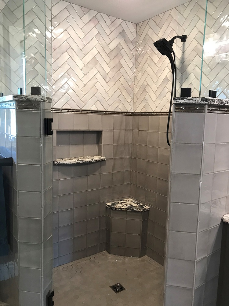 Herringbone patterned tiled shower
