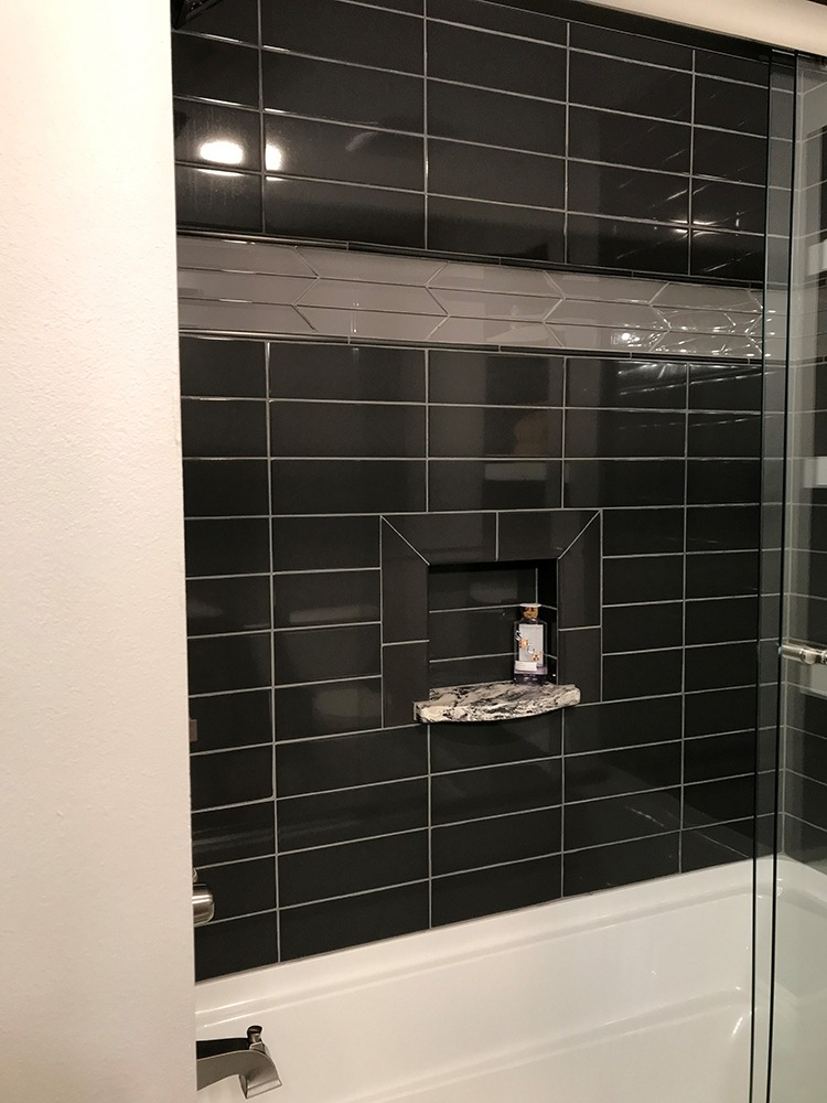 Stacked black tile tub surround