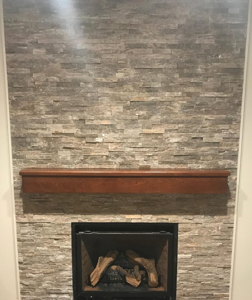 Fireplace after stacked stone, dark mantle